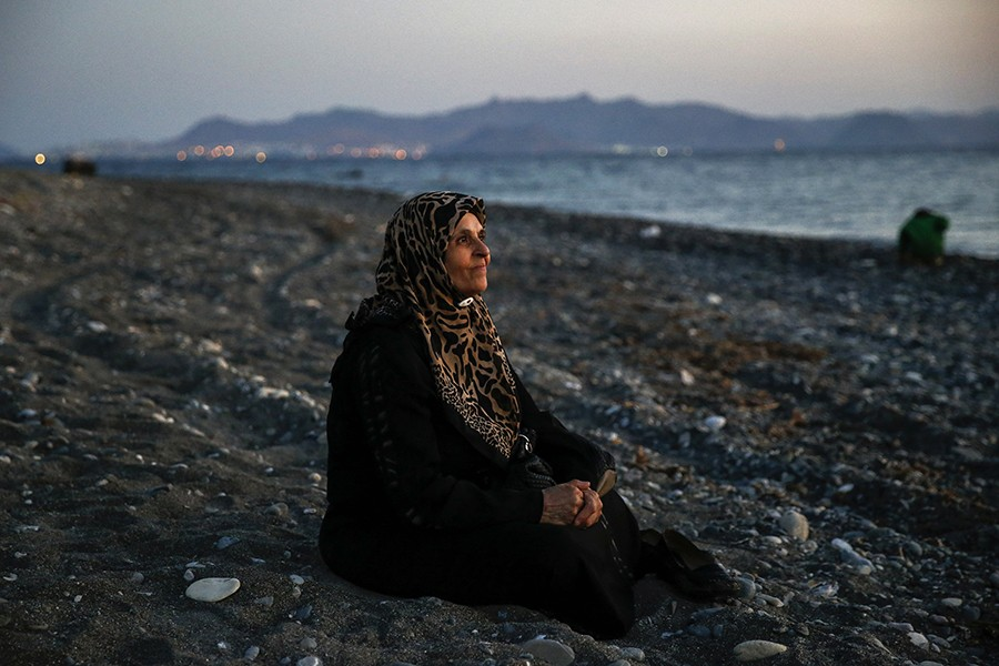 Amoun, 70, a blind Palestinian refugee who lived in the town of Aleppo in Syria, rests on a beach moments after arriving along with another forty on a dinghy in the Greek island of Kos, crossing a part of the Aegean Sea from Turkey to Greece (Yannis Behrakis, Thomson Reuters - August 12, 2015).